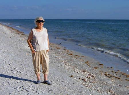 elderly woman standing on beach Sanibel Island Florida Stock Photo - 2770851
