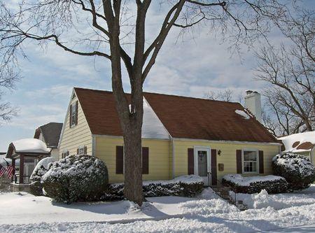 snowy single  home in urban neighborhood photo