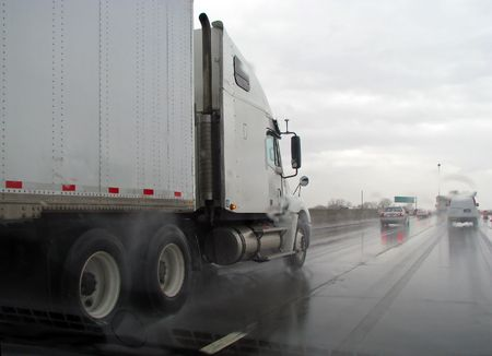 truck on wet highway in the rain