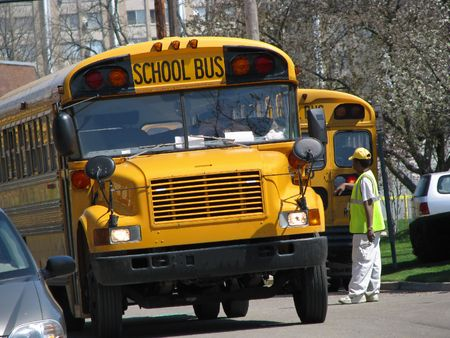 view of man directing school bus traffic Stock Photo