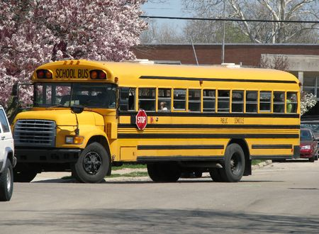 view of school bus driving on road