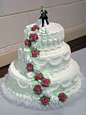 creamy white wedding cake with burgundy roses Stock Photo