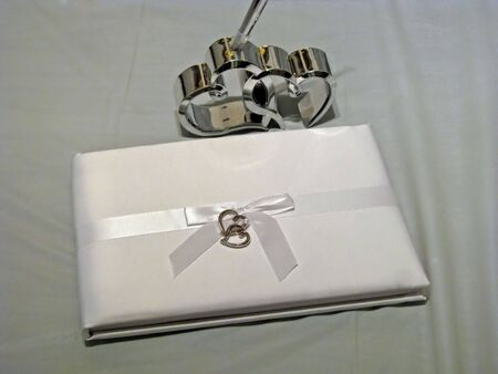 wedding guest book with ribbon and hearts photo