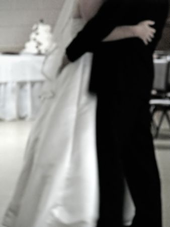 bride and groom first dance at wedding reception photo