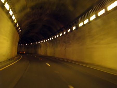 traveling in a long underground lighted tunnel Stock Photo