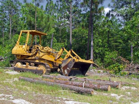 back hoe: bulldozer sitting unattended at a construction site Stock Photo