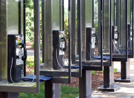 a row of identical pay phone booths