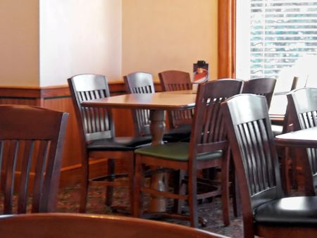 dining table and chairs: empty table and chairs in casual restaurant