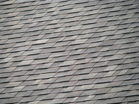 background of gray rectangular shingles on roof