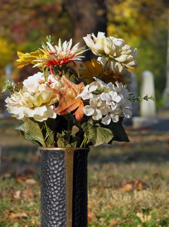 Silk flowers in cemetery grave vase autumn stock photo picture and silk flowers in cemetery grave vase autumn stock photo 3804827 mightylinksfo