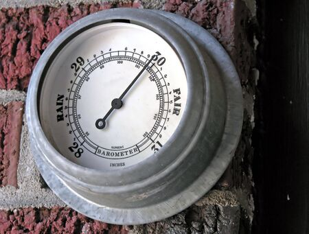 barometer with needle pointing towards fair weather Stock Photo