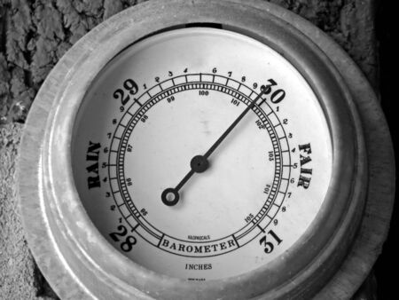 barometer with needle pointing towards fair weather photo