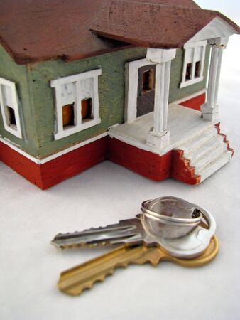 toy house sitting by set of keys photo