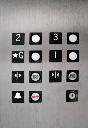 panel: inside of old elevator floor number buttons