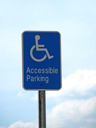 handicap accessible parking sign against blue sky Stock Photo - 4434381