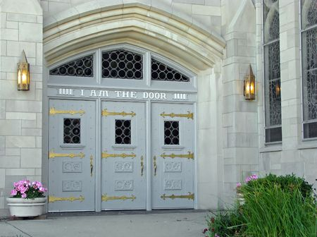 white church doors with lighted front entrance photo