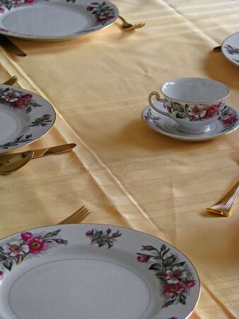 place setting of fine china and gold ware photo