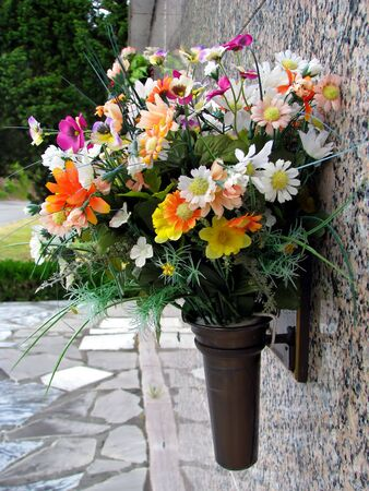 niche: colorful silk flower vases in summer cemetery