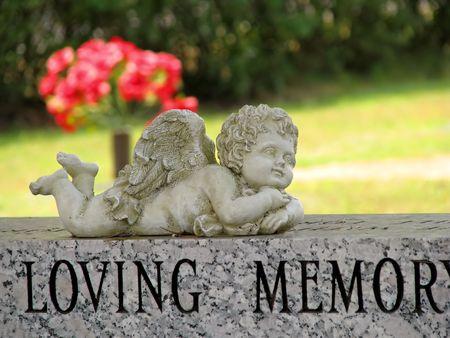 in loving memory: angel statue cemetery grave tombstone loving memory