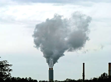 spewing: chimney spewing smoke pollution into overcast sky