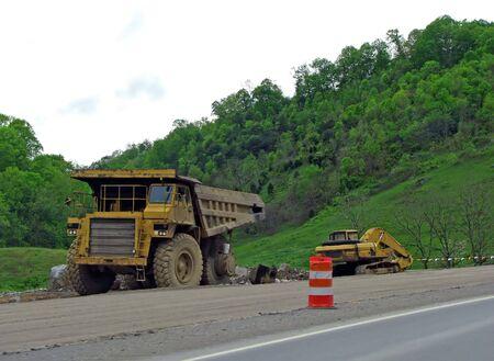 heavy machine equipment on mountain highway construction