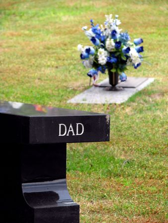 cemetery grave tombstone engraved with word dad Stok Fotoğraf
