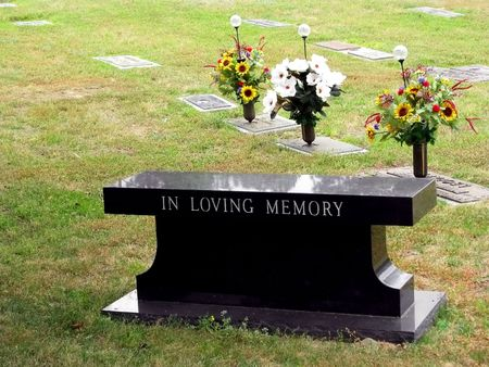 in loving memory: cemetery grave tombstone engraved in loving memory