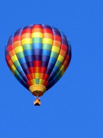 single colorful hot air balloon in blue sky photo