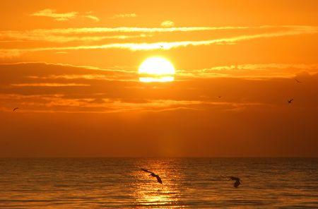 breaking wave: A Beautiful Sunrise On Sanibel Island Florida Stock Photo