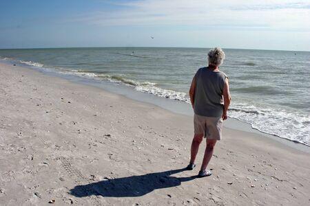 elderly woman on beach Sanibel Island Florida Stock Photo - 7056893