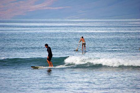 05062010  People Surfing on Ocean Waves Maui Hawaii USA
