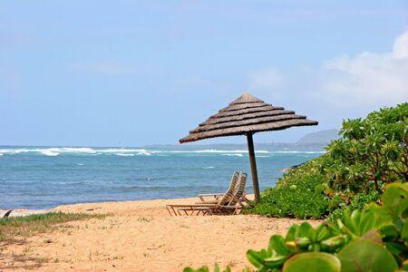 Tiki Beach Umbrella and Lounge Chairs; Tropical Kauai Hawaii photo