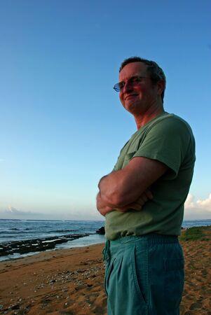 Middle-age Man On Beach at Sunrise Kauai Hawaii photo