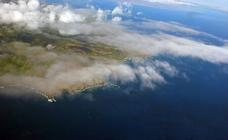 lofty: Aerial View Beautiful Cloud Formation over Pacific Island Stock Photo