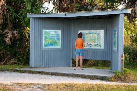 ding: Woman Reading Map Ding Darling Sanibel Florida ; Bailey Tract