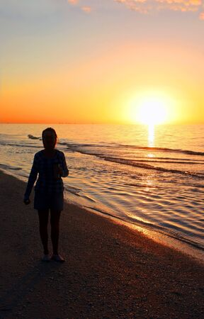 reflect: Woman Silhouette at Sunrise Sanibel Florida Beach