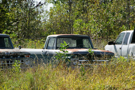 vacant lot: FAIRLAND, OK - OCTOBER 09: Old Used Trucks Parked in Rural Vacant Lot 2013