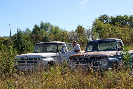 see the usa: FAIRLAND, OK - OCTOBER 09: Old Used Trucks Parked in Rural Vacant Lot 2013