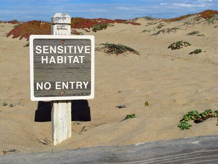 wording: Sensitive Habitat Sign on Sand Dunes at Monterey Bay Beach California Stock Photo