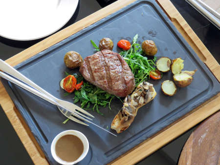 angus: Black Angus Beef Dinner From the Grill Stock Photo