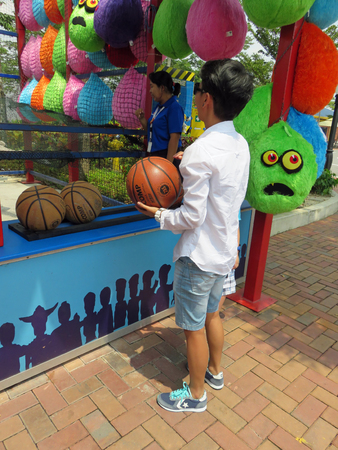 international basketball: JOHOR MALAYSIA  - NOVEMBER 11:  Basketball Shoot Arcade Game LEGOLAND Malaysia Theme Park November 11, 2014  in Johor, Malaysia Editorial