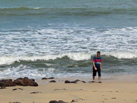 uninterrupted: Man Walking on Desaru Beach Johor Malaysia Stock Photo