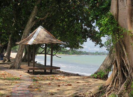 tiki: Tiki Hut on the Beautiful Beach of Johor Malaysia Stock Photo