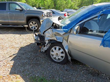 damaged car in impound lot after an head on collision Editorial