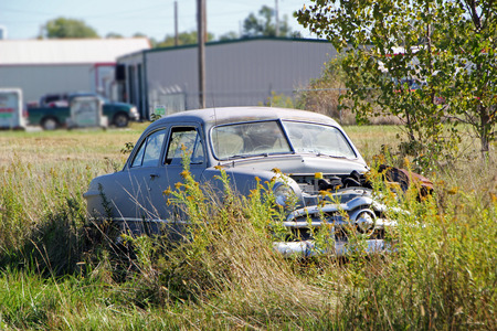 FAIRLAND, OK - OCTOBER 09: Old Used Car Parked in Rural Vacant Lot 2013 Editorial