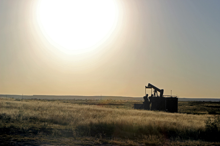 Oil Well Pumper in West Texas Field Afternoon Sun