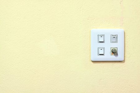 four switch on a yellow wall  Stock Photo - 7972210