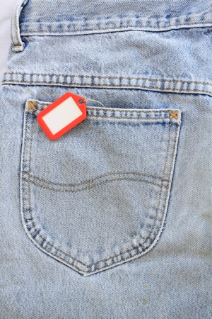 Blue jeans pocket with blank badge  photo