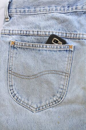 Blue jeans pocket with mobile phone Stock Photo - 8941641