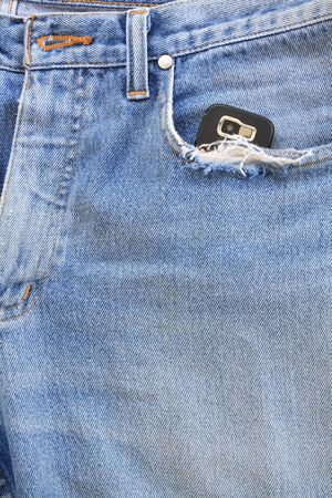 Blue jeans pocket with mobile phone Stock Photo - 8941650
